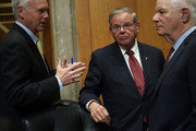 Committee ranking member U.S. Sen. Bob Menendez (D-NJ) (2nd L) and Sen. Ben Cardin (D-MD) (R) listen to Sen. Ron Johnson (R-WI) (L) during a Senate Foreign Relations Committee meeting April 23, 2018 on Capitol Hill in Washington, DC. The committee has approved to the nomination of CIA Director Mike Pompeo to be the next Secretary of State.