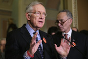 Senate Minority Leader Harry Reid (D-NV) (L) talks to reporters with Sen. Charles Schumer (D-NY) (R) following the Senate Democratic caucus policy luncheon at the U.S. Capitol January 12, 2016 in Washington, DC. Reid enumerated what he believes are President Barack Obama's greatest political accomplishments ahead of tonight's State of the Union speech.