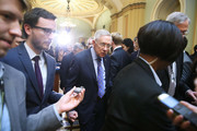 Outgoing Senate Minority Leader Harry Reid (D-AZ), (C), walks away after speaking to the media after attending a weekly luncheon with Senate Democrats at the Capitol, December 6, 2016 in Washington, DC. Senate Democrats gathered at the weekly luncheon to discuss their upcoming agenda.