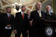 U.S. Senate Majority Leader Sen. Mitch McConnell (R-KY) (4th L) speaks as (L-R) Sen. Cory Gardner (R-CO), Sen. John Barrasso (R-WY), Sen. Roy Blunt (R-MO) and Senate Majority Whip Sen. John Cornyn (R-TX) listen during a news briefing after a weekly policy luncheon July 17, 2018 at the U.S. Capitol in Washington, DC. Senate GOPs participated in a weekly luncheon to discuss Republican agenda.