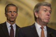 Sen. John Thune (R-SD) listens as Sen. Roy Blunt (R-MO) speaks during a weekly news conference on Capitol Hill  on August 21, 2018 in Washington, DC.