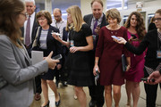 Sen. Susan Collins (R-ME) (3rd l) Sen. Lisa Murkowski (R-AK) (3rd R) are pursed by reporters as they head for the weekly Senate Republican policy luncheon at the U.S. Capitol October 02, 2018 in Washington, DC. Senate GOP leaders agreed last week with the Judiciary Committee to allow the FBI to conduct a one-week investigation into sexual assault allegations against Supreme Court nominee Judge Brett Kavanaugh before the Senate votes on his confirmation.