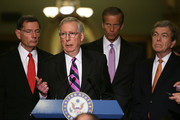 U.S. Senate Majority Leader Sen. Mitch McConnell (R-KY) (2nd L) speaks to members of the media at the Capitol as (L-R) Sen. John Barrasso (R-WY), Sen. John Thune (R-SD) and Sen. Roy Blunt (R-MO) listen August 1, 2017 in Washington, DC. Senate Republicans held their weekly policy luncheon to discuss the GOP agenda.
