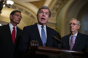 Sen. Roy Blunt (R-MO) speaks beside Sen. John Thune (R-SD), left, and Senate Majority Leader Mitch McConnell (R-KY), right, during a news conference following the weekly Senate Republicans policy luncheon, on Capitol Hill, on July 10, 2018 in Washington, DC.