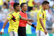 Radamel Falcao of Colombia and referee Milorad Mazic  speak to James Rodriguez of Colombia as he is substituted off due to injury during the 2018 FIFA World Cup Russia group H match between Senegal and Colombia at Samara Arena on June 28, 2018 in Samara, Russia.