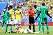 Referee Milorad Mazic  speaks with Cheikhou Kouyate of Senegal after he fouls Radamel Falcao of Colombia who goes down injured during the 2018 FIFA World Cup Russia group H match between Senegal and Colombia at Samara Arena on June 28, 2018 in Samara, Russia.