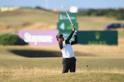 Thaworn Wiratchant of Thailand plays his second shot on the 16th fairway during Day One of The Senior Open Presented by Rolex at The Old Course on July 26, 2018 in St Andrews, Scotland.