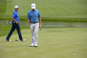Jerry Kelly walks on the green as David Toms misses a putt on the third hole during the final round of the U.S. Senior Open Championship at The Broadmoor Golf Club on July 1, 2018 in Colorado Springs, Colorado.