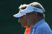 Bernhard Langer of Germany (L) walks alongside Colin Montgomerie of Scotland on the tenth hole during the first round of the 2013 U.S. Senior Open Championship at Omaha Coutry Club on July 11, 2013 in Omaha, Nebraska.
