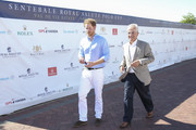 Prince Harry and Chairman of Sentebale Philip Green arrive at the Sentebale Royal Salute Polo Cup at Val de Vie Estate on November 28, 2015 in Paarl, South Africa.