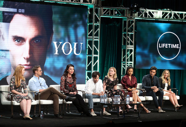 Summer 2018 TCA Press Tour - Day 2 [television show,event,performance,stage,music artist,advertising,television program,convention,news conference,greg berlanti,sarah schechter,sera gamble,caroline kepnes,john stamos,shay mitchell,l-r,tca,press tour]