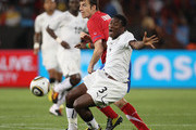Asamoah Gyan of Ghana is tackled by Aleksandar Lukovic of Serbia during the 2010 FIFA World Cup South Africa Group D match between Serbia and Ghana at Loftus Versfeld Stadium on June 13, 2010 in Pretoria, South Africa.