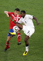 Asamoah Gyan of Ghana controls the ball in front of Aleksandar Lukovic of Serbia during the 2010 FIFA World Cup South Africa Group D match between Serbia and Ghana at Loftus Versfeld Stadium on June 13, 2010 in Pretoria, South Africa.