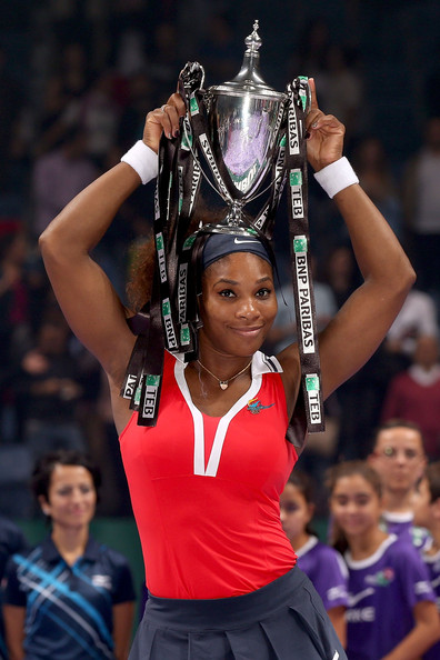 Serena Williams Serena Williams of the United States poses for photographers with the Billy Jean King Trophy after defeating Maria Sharapova of Russia during the final of the TEB BNP Paribas WTA Championships at the Sinan Erdem Dome October 28, 2012 in Istanbul, Turkey.