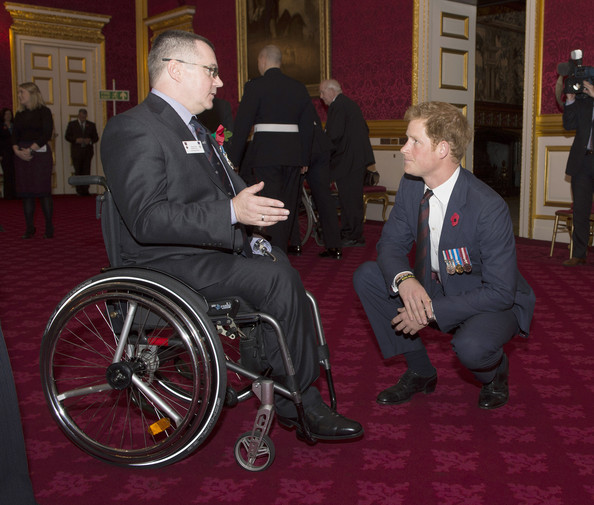 Prince Harry chats with Major Peter Norton GC as he hosts the President's Party in remembrance and re-dedication for members of the Victoria Cross and George Cross Association in the State Apartments at St James's Palace on October 29, 2014 in London, England.
