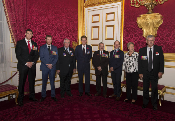 Prince Harry poses with (L-R) Corporal Ben Roberts Smith VC, Corporal Dan Keighran VC, Michael Pratt GC, Keith Payne VC OAM DSC, Corporal Mark Donaldson VC, Kaye and Doug Baird (parents of Cameron Baird VC) the President's Party in remembrance and re-dedication for members of the Victoria Cross and George Cross Association in the State Apartments at St James's Palace on October 29, 2014 in London, England.