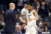 Trevon Bluiett #5 of the Xavier Musketeers  is congratulated by head coach Chris Mack as he leaves the court for the last time during the game against the Seton Hall Pirates at Cintas Center on February 14, 2018 in Cincinnati, Ohio.