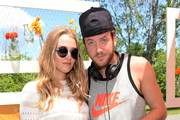 Elizabeth Gilpin and DJ Nick Cohen attend the seventh annual Veuve Clicquot Polo Classic in Liberty State Park on May 31, 2014 in Jersey City City.