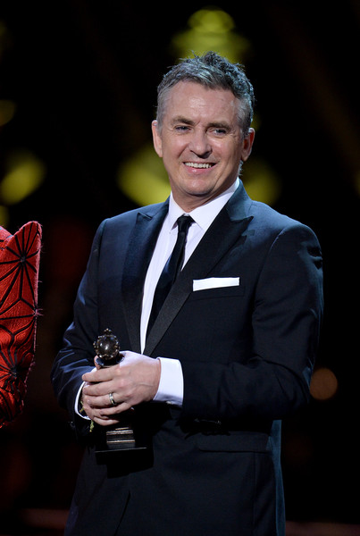 The Olivier Awards 2019 With Mastercard - Show [suit,formal wear,tuxedo,official,speech,event,public speaking,award,white-collar worker,businessperson,shane richie,olivier awards,stage,england,london,royal albert hall,mastercard,mastercard - show,the olivier awards]