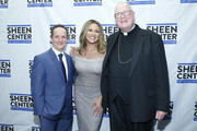 David Di Certo, Vanessa Williams and Cardinal Timothy Dolan attend Sheen Center presents Vanessa Williams & Friends: thankful for Christmas with guests Norm Lewis, Michael Urie, and Bernie Williams at Sheen Center for Thought & Culture on November 18, 2019 in New York City.