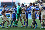 Chris Kirkland of Sheffield Wednesday breaks up a fight, after Matt Smith of Leeds United challenge on Reda Johnson of Sheffield Wednesday during the Sky Bet Championship match between Sheffield Wednesday and Leeds United at Hillsborough Stadium on January 11, 2014 in Sheffield, England,