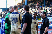 Referee Lee Probert sends off Matt Smith of Leeds United after his challenge on Reda Johnson of Sheffield Wednesday during the Sky Bet Championship match between Sheffield Wednesday and Leeds United at Hillsborough Stadium on January 11, 2014 in Sheffield, England,