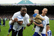 Jermaine Johnson, Reda Johnson and Rob Jones of Sheffield Wednesday celebrate after winning the Npower League One match between Sheffield Wednesday and Wycombe Wanderers and winning automatic promotion into the Championship at Hillsborough Stadium on May 5, 2012 in Sheffield, England.
