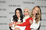 (L-R) Models Pia Wurtzbach, Carmen Dell'Orefice and Olivia Jordan attend the Sherri Hill Fall 2016 fashion show during New York Fashion Week: The Shows on February 12, 2016 in New York City.