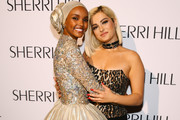 Model Halima Aden and singer Bebe Rexha attend the Sherri Hill NYFW Spring 2020 runway show at Cipriani 42nd Street on September 06, 2019 in New York City.