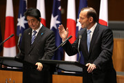Japanese Prime Minister Shinzo Abe addresses the Australian Government in the House of Representatives with Australian Prime Minister Tony Abbott (R) at Parliament House on July 8, 2014 in Canberra, Australia. Prime Minister is in Australia for three days and will sign a Economic Partnership Agreement with Australia. Japan is Australia's second biggest trading partner.