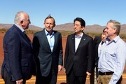 (L-R) Rio Tinto CEO, Sam Walsh, Prime Minister Tony Abbott, Prime Minister of Japan, Shinzo Abe, and WA premier Colin Barnett arrive for a tour of the Rio Tinto West Angelas iron ore mine on July 9, 2014 in the Pilbara, West Australia. The Japanese Prime Minister is in Australia for three days and will sign a Economic Partnership Agreement with Australia. Japan is Australia's second biggest trading partner.
