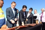 Prime Minister Tony Abbott  and Japanese Prime Minister Shinzo Abe examine a boomerang during a tour of the Rio Tinto West Angelas iron ore mine in the Pilbara on July 9, 2014 in the Pilbara, West Australia. The Japanese Prime Minister is in Australia for three days and will sign a Economic Partnership Agreement with Australia. Japan is Australia's second biggest trading partner.