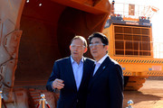 Prime Minister Tony Abbott (L) and Japanese Prime Minister Shinzo Abe during a tour of the Rio Tinto West Angelas iron ore mine in the Pilbara on July 9, 2014 in the Pilbara, West Australia. The Japanese Prime Minister is in Australia for three days and will sign a Economic Partnership Agreement with Australia. Japan is Australia's second biggest trading partner.