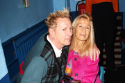(UK TABLOID NEWSPAPERS OUT) John Lydon formally of The Sex Pistols and Pil and his wife Nora Forster pose in front of the winners boards at the Shockwaves NME Awards 2011 held at Brixton Academy on February 23, 2011 in London, England.
