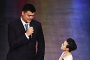 Presenter Chen Chen speaks with former Basketball player Yao Ming of China during the 2015 Laureus World Sports Awards show at the Shanghai Grand Theatre on April 15, 2015 in Shanghai, China.