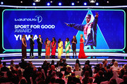 Neeta Kumari, Hema Kumari, Konika Kumari, Radha Kumari, and Franz Gastler and Rose Gastler of the Yuwa Football Girls team, a football-based charity from India winners of the Laureus Good For Sport Award accepts their Laureus award on stage as Laureus Academy Member Missy Franklin and hosts James Marsden ,Amanda Davies look on during the 2019 Laureus World Sports Awards on February 18, 2019 in Monaco, Monaco.