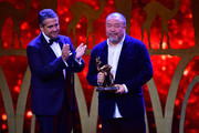 Sigmar Gabriel is seen on stage with 'Mut' Award Winner Ai Weiwei during the Bambi Awards 2017 show at Stage Theater on November 16, 2017 in Berlin, Germany.