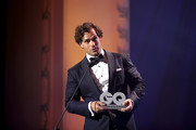 Henry Cavill speaks on stage after receiving his award during the GQ Men of the Year Award show at Komische Oper on November 8, 2018 in Berlin, Germany.