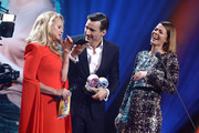 Barbara Schoeneberger and award winners Florian David Fitz and Jessica Schwarz on stage during the GQ Men of the Year Award show at Komische Oper on November 07, 2019 in Berlin, Germany.