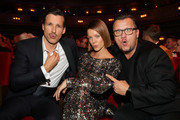 Florian David Fitz, Jessica Schwarz and Torsten Koch pose during the 21st GQ Men of the Year Award at Komische Oper on November 07, 2019 in Berlin, Germany.
