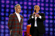 (L-R) Alan Cumming and Tom Viola speak on stage during the Life Ball 2019 show at City Hall on June 08, 2019 in Vienna, Austria. After 26 years the charity event Life Ball will take place for the very last time, raising funds for HIV & AIDS projects.