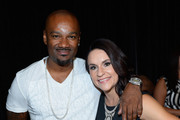 """Television personality Darian """"Big Tigger"""" Morgan (L) and Intern Coach Jen Welter arrive at the VIP Pre-Fight Party for 'High Stakes: Mayweather v. Berto' presented by Showtime at the MGM Grand Garden Arena on September 12, 2015 in Las Vegas, Nevada."""