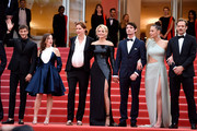 """(L-R) Gaspard Ulliel, Laure Calamy, Justine Triet, Virginie Efira, Niels Schneider, Adele Exarchopoulos and Paul Hamy attend the screening of """"Sibyl"""" during the 72nd annual Cannes Film Festival on May 24, 2019 in Cannes, France."""
