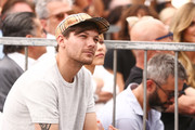 Louis Tomlinson attends a ceremony honoring Simon Cowell with a star on the Hollywood Walk of Fame on August 22, 2018 in Hollywood, California.