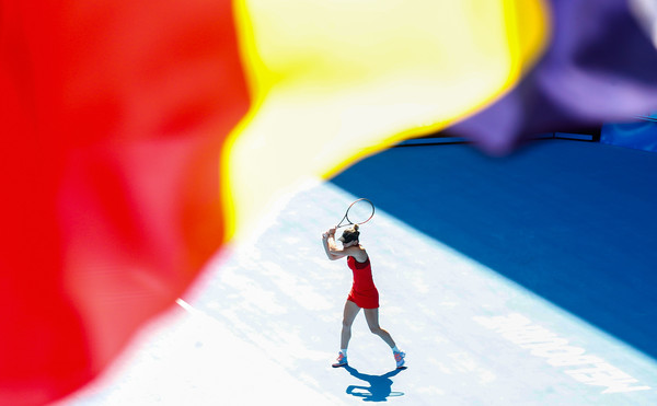 2018 Australian Open - Day 11 [red,yellow,recreation,fun,ice skating,photography,skating,extreme sport,illustration,sports equipment,simona halep,angelique kerber,air,waves,shot,romania,melbourne park,flag of romania,australian open,match]
