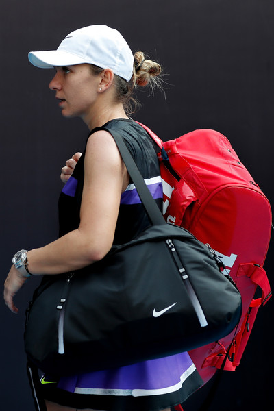 2019 China Open - Day 2 [product,shoulder,bag,tennis,fashion accessory,luggage and bags,magenta,women,simona halep,rebecca peterson,romania,china national tennis center,court,china open,game,singles,match]