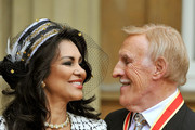 Sir Bruce Forsyth and his wife Wilnelia pose after he was knighted by Queen Elizabeth II at Buckingham Palace on October 12, 2011 in London, England. The Strictly Come Dancing host's place as a leading TV presenter is recognised after years of campaigning by fans.
