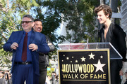 Shawn Mendes speaks as Lionel Richie and Sir Lucian Grainge stand by as Grainge is honored with a star on the Hollywood Walk of Fame on January 23, 2020 in Hollywood, California.