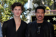 Shawn Mendes (L) and Lionel Richie attend an event honoring Sir Lucian Grainge with a star on the Hollywood Walk of Fame on January 23, 2020 in Hollywood, California.