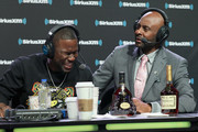 Kevin Hart and Jerry Rice attend SiriusXM at Super Bowl LIII Radio Row on February 01, 2019 in Atlanta, Georgia.